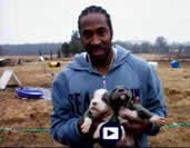 MICHEAL DICKERSON COMES TO MUGLESTON'S. My friend Micheal Dickerson, a professional Basketball player for the Seattle Sonics, holding his Monster Mugleson's puppies. These puppies were pictured as adults in a four page article in Slam Magazine Dec. 04 issue. Thanks Micheal.